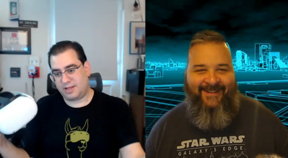 Joel on the left is holding an Oculus Quest virtual reality headset. Jay on the right is laughing at Joel's funny comment.